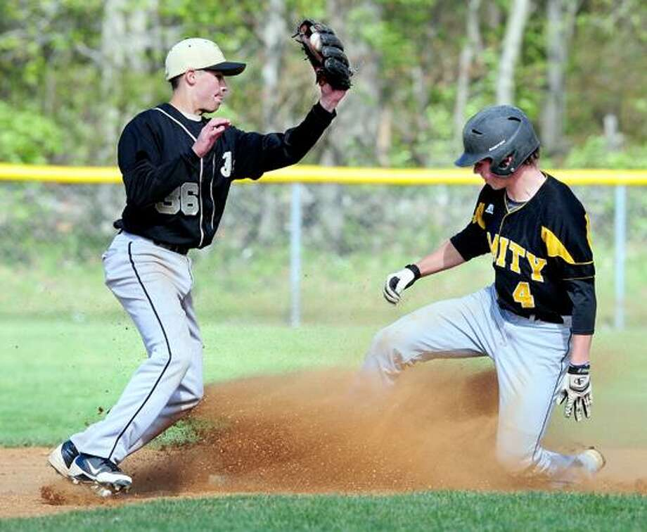 Keith Klebart (right) of Amity steals second as Jimmy Palmer (left) of Jonathan Law fields a late throw in the early innings on 4/27/2012.Photo by Arnold Gold/New Haven Register   AG0447C