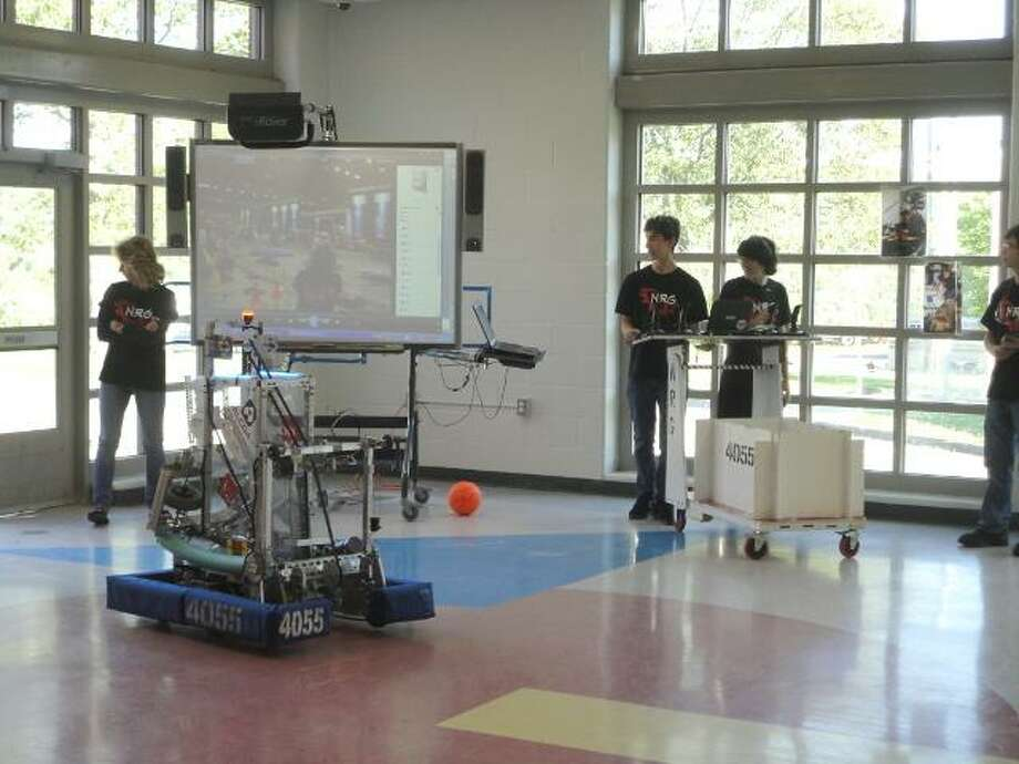 The Northwestern Gearheads put their robot through the paces to help convince the Region 7 Board of Education to support more science, technology, engineering and mathematics education. (JASON SIEDZIK / Register Citizen)