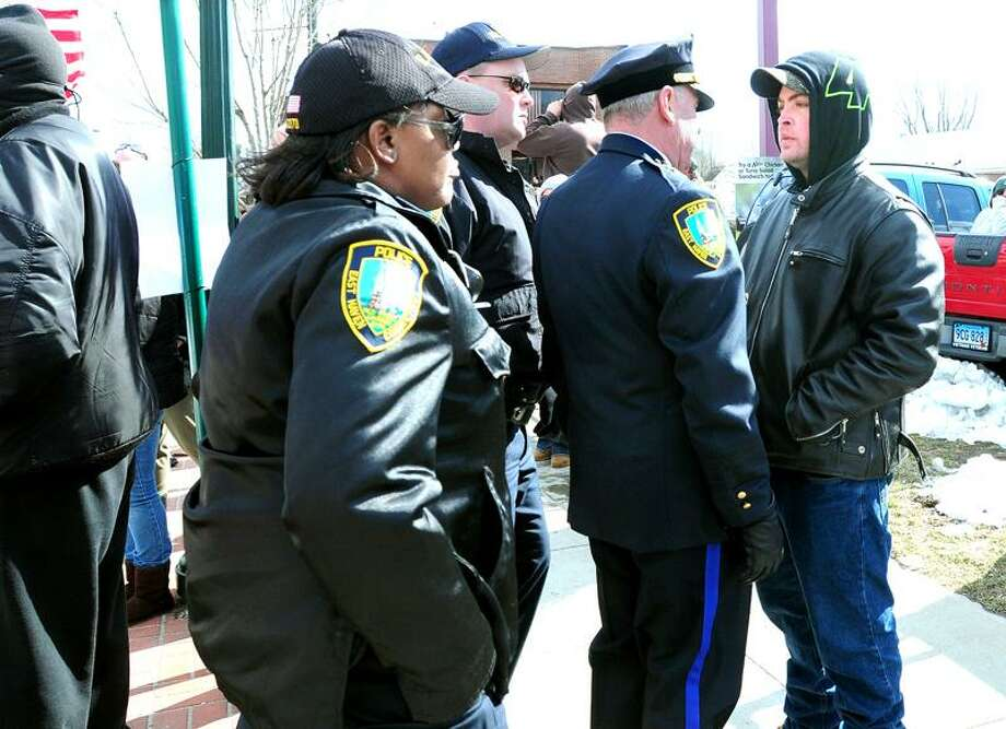 East Haven Acting Police Chief Brent Larrabee (right) confronts a counter protestor (far right) during a unity march on Main St. in East Haven on 2/25/2012. Photo by Arnold Gold/New Haven Register