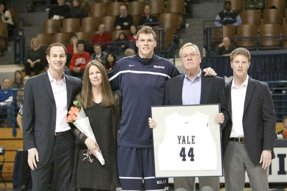 Photo courtesy of Yale Athletics Yale senior Greg Mangano, along with his parents Ron and Betsy and brothers Mike and Matt took part in Senior Night festivities Saturday.