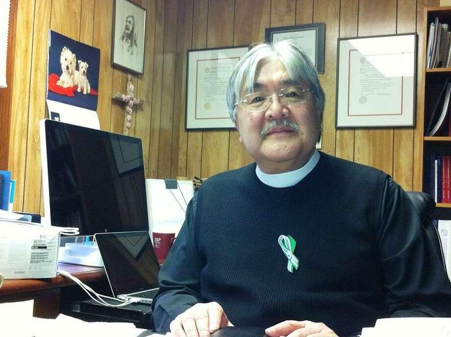 Sandy Hook United Methodist Church Rev. Mel Kawakami in his office. Mark Zaretsky/Register