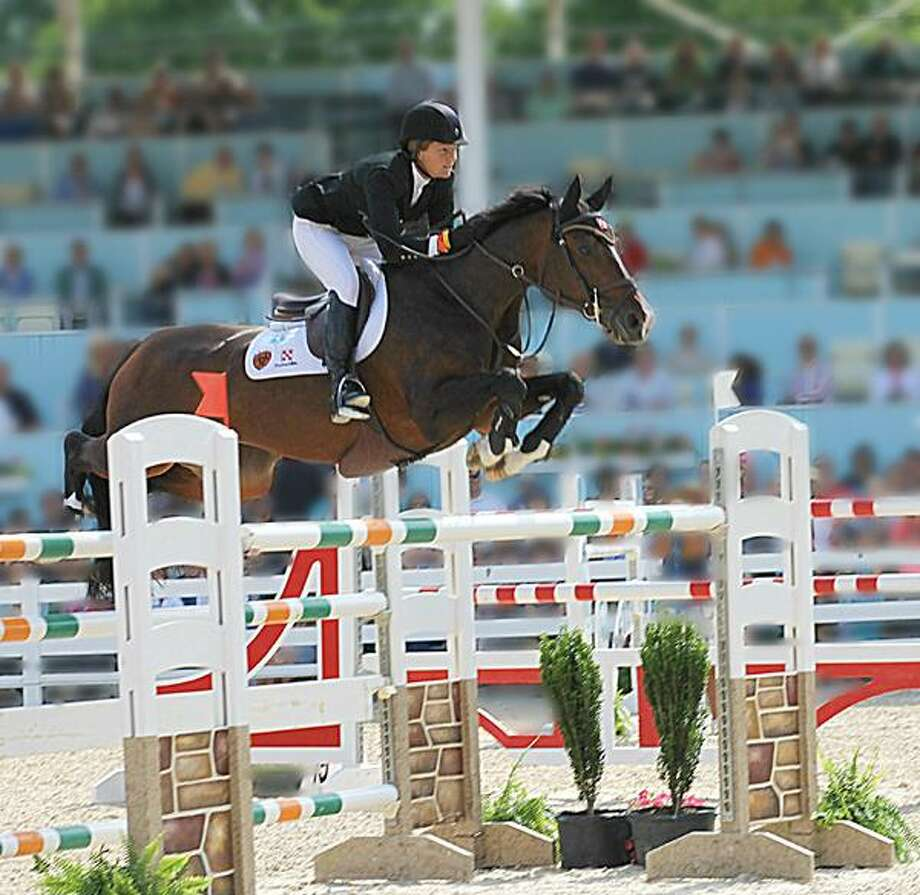 "Submitted Photo by HELENE H. GALLAGHER Elizabeth ""Beezie"" Madden rides her second-ranked horse Coral Reef Vida Volo. The Cazenovia resident hopes to help Team USA to its third consecutive gold medal in show jumping at the London Olympics this summer."
