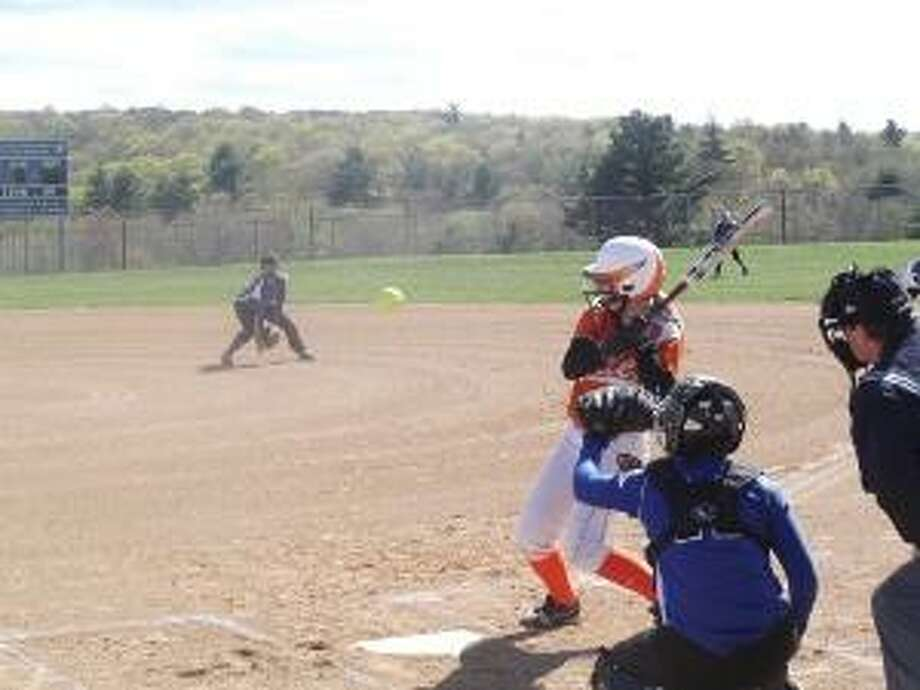 KEVIN D. ROBERTS/Register Citizen Terryville's Sarah Ercoli gets out of the way of an inside pitch during Friday afternoon's 6-5 Berkshire League loss to Lewis Mills at Lewis Mills High School. The Spartan catcher is Falisia Murphy.