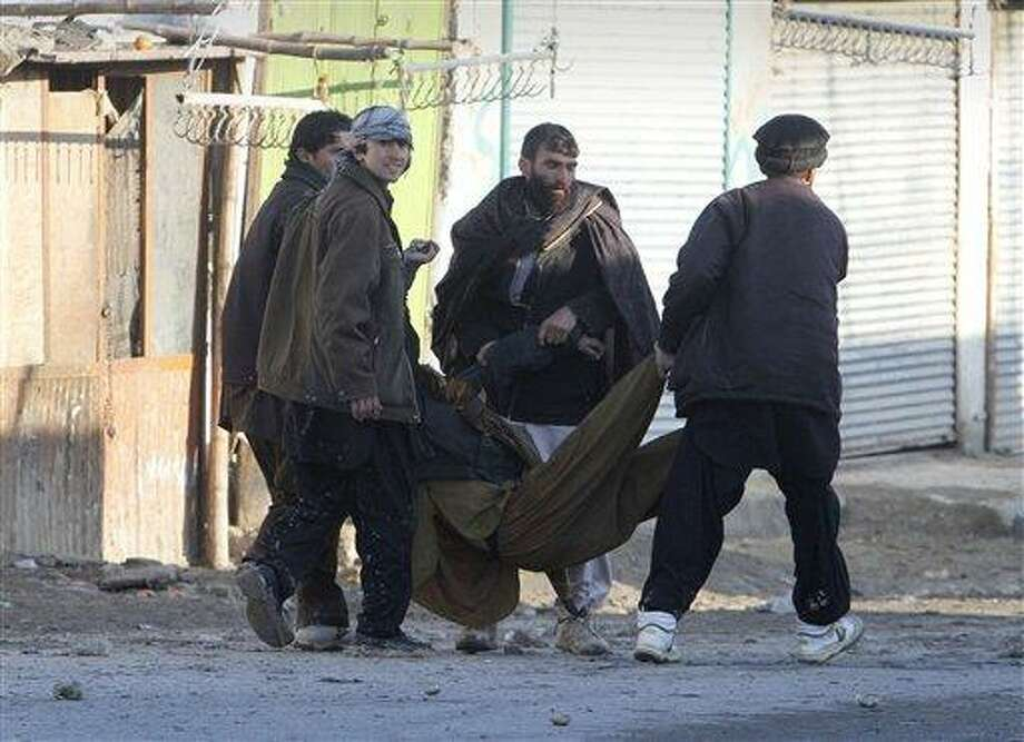 A wounded protestor is being carried during an anti-U.S. demonstration in Kabul, Afghanistan, Friday. Thousands of Afghans staged new demonstrations Friday over the burning of Qurans at a U.S. military base. Associated Press Photo: AP / AP