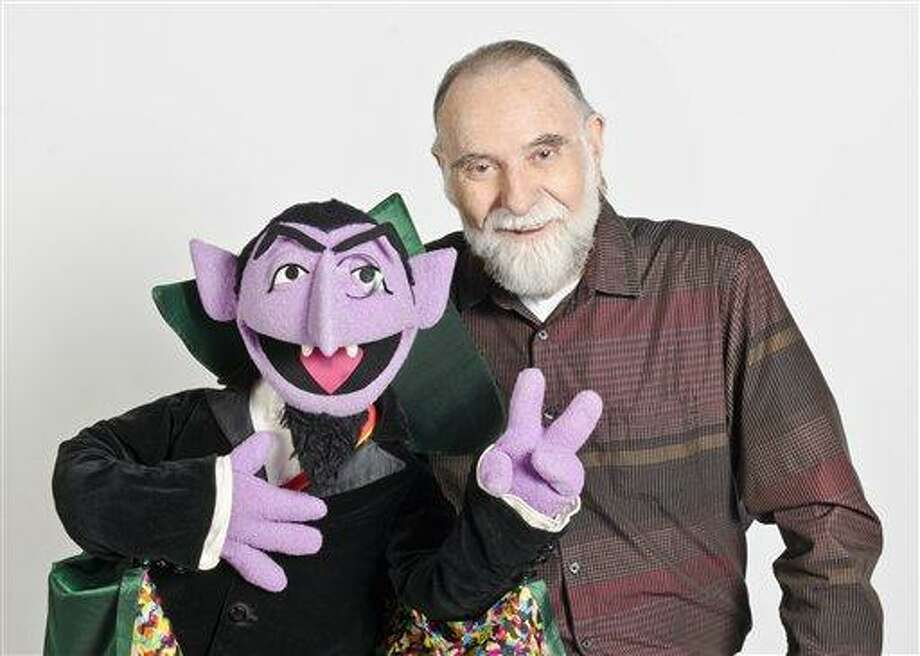 """In this June 2012 publicity photo released by """"Sesame Street,"""" puppeteer Jerry Nelson is shown with """"Sesame Street"""" character Count von Count in New York. Sesame Workshop announced that Nelson, who suffered from emphysema, died at age 78 on Thursday, Aug. 23, 2012, in his Massachusetts home on Cape Cod. (AP Photo/Sesame Workshop, Gil Vaknin) Photo: ASSOCIATED PRESS / AP2012"""