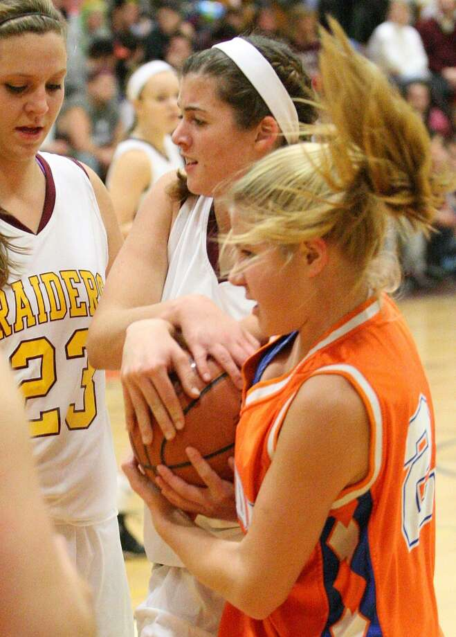 """Dispatch Staff Photo by JOHN HAEGER <a href=""""http://twitter.com/oneidaphoto"""">twitter.com/oneidaphoto</a> Canastota's Abby Laflair and Oneida's Jillian Brodock, right, tie up a loose ball as Canastota's Shea Foster (23) looks on in the first half of their game in Canastota on Friday, Dec. 21, 2012."""