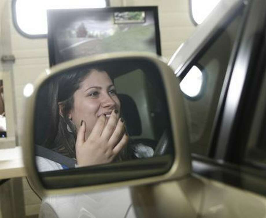 Dispatch Staff Photo by JOHN HAEGER (Twitter.com/OneidaPhoto) VVS senior Sabrina Verdgeline reacts as she tries to drive a simulator car and crashes to see the effects of alcohol while driving during an Alcohol Awareness Event held at the school on Friday, April 27, 2012 in Verona.