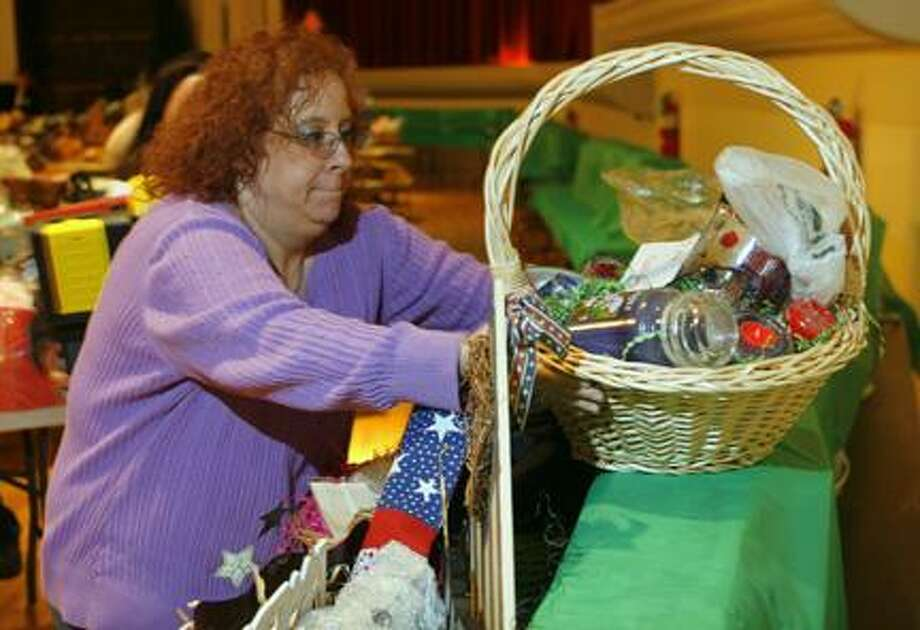 Photo by JOHN HAEGER (Twitter.com/OneidaPhoto) Sue DiRuzzo readies baskets for St. Patrick's School's 19th annual Basket Bonanza on Friday at the Kallet Civic Center in Oneida. The event will take place on Saturday, April 28, 2012, with the doors opening at 4 p.m. and drawing at 8 p.m.
