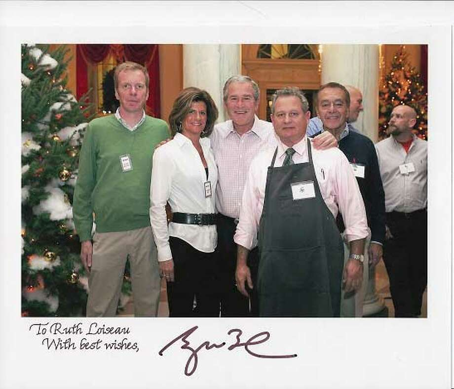 Ruth Loiseau, second from left, with former President George W. Bush. Ms. Loiseau is coming to Litchfield for a talk that is open to the public.