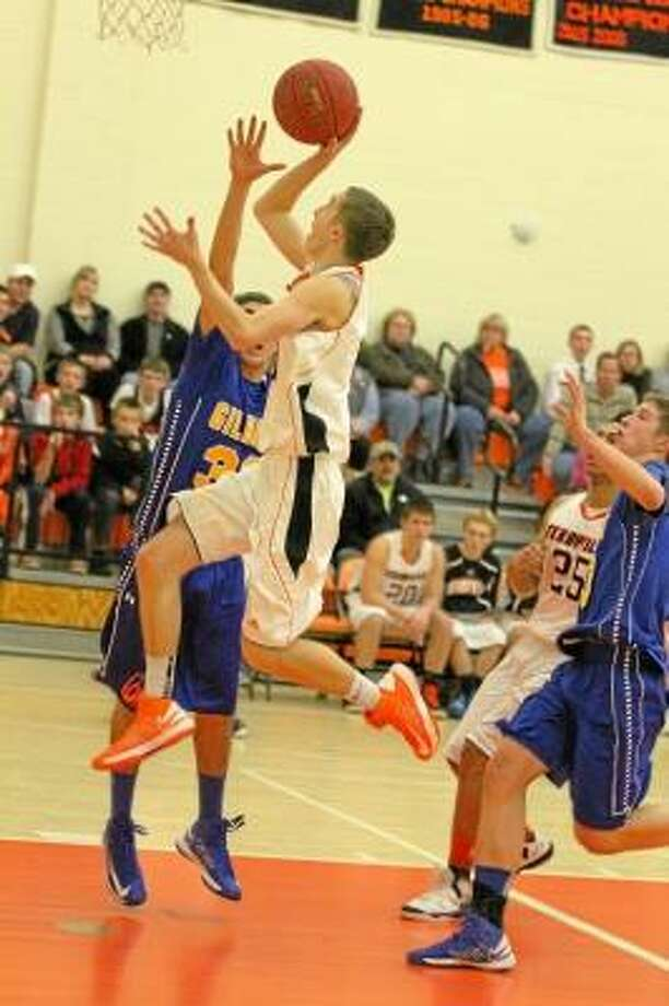 Terryville's Tyler Trillo attempts a lay-up in the paint against Gilbert. Photo by Marianne Killackey/Special to Register Citizen / 2012