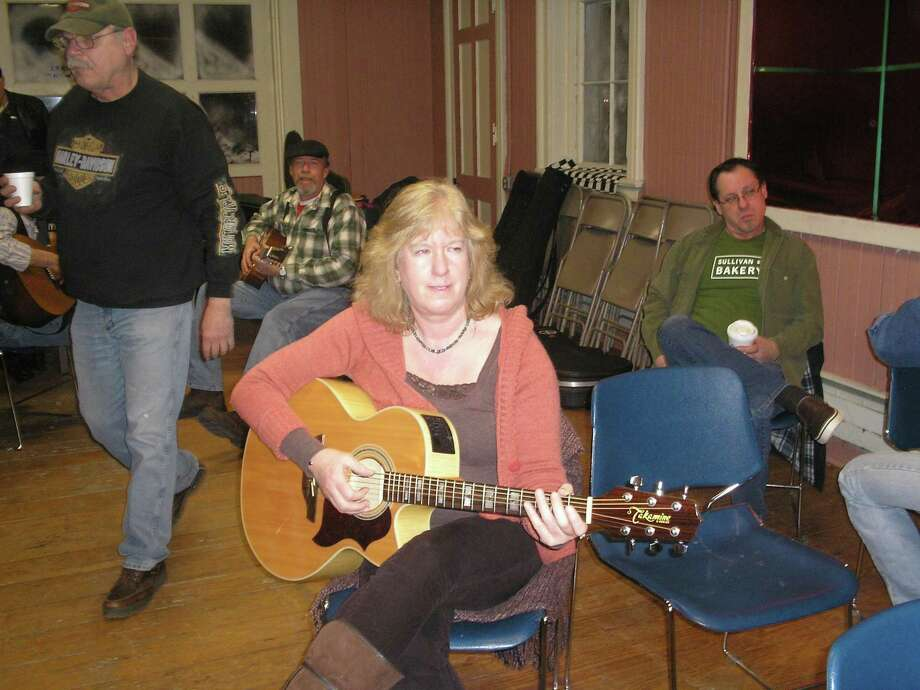 Photo by Dan Canfield Jean Recchia joined other musicians during the recent Coffee House Open Mike Night at the Thomaston Opera House in Thomaston. The event includes a group that has met for many years in the community.