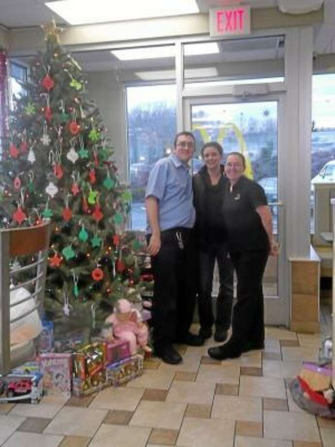 NIKKI TRELEAVEN/The Register Citizen  East Main Street McDonald's in Torrington raised more than $3,000 to buy more than 300  toys that will be distributed to four local charities: Susan B. Anthony Project, Torrington Chapter of FISH, Torrington Fire Department and the State Police Department Toy's for Tots drive. Department Manager Robbi Licina and McDonald's employee Mary Mastrobuono with state Police Officers Greg Zordan, left, and Mike Burke.