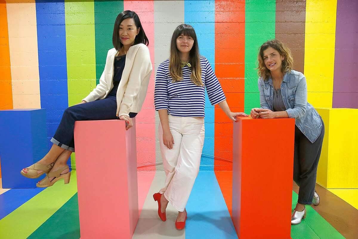 Art direction and design Erin Jang (left), founder Jordan Ferney (middle), and creative direction Leah Rosenberg (right) in the scratch and sniff room is part of the Color Factory two-story interactive exhibition on Tuesday, July 25, 2017, in San Francisco, Calif.