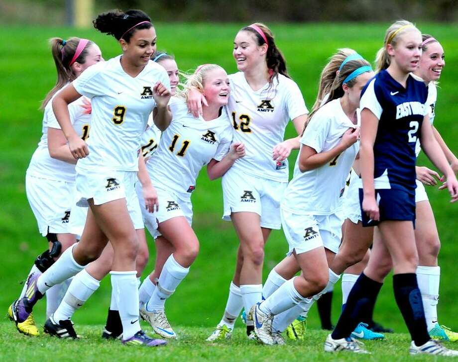 Amity players congratulate Dakota Kelly (11) after she scored a goal to put Amity up 2-0 in the first half against East Haven. Amity won 3-0. Photo by Arnold Gold/New Haven Register