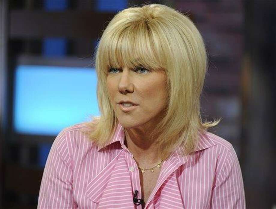 """This image released by ABC shows Rielle Hunter during an interview on the morning show """"Good Morning America"""" Tuesday. Hunter says she and former presidential candidate John Edwards have ended their relationship. Hunter told ABC's """"Good Morning America"""" on Tuesday that she and Edwards were still a couple until late last week, as details from Hunter's memoir, """"What Really Happened: John Edwards, Our Daughter and Me,"""" became public. The breakup was painful, but Hunter said Edwards will still be involved with their daughter, Quinn, who is 4 years old and lives with Hunter. Associated Press Photo: AP / ©2012 American Broadcasting Companies, Inc.  All rights reserved."""
