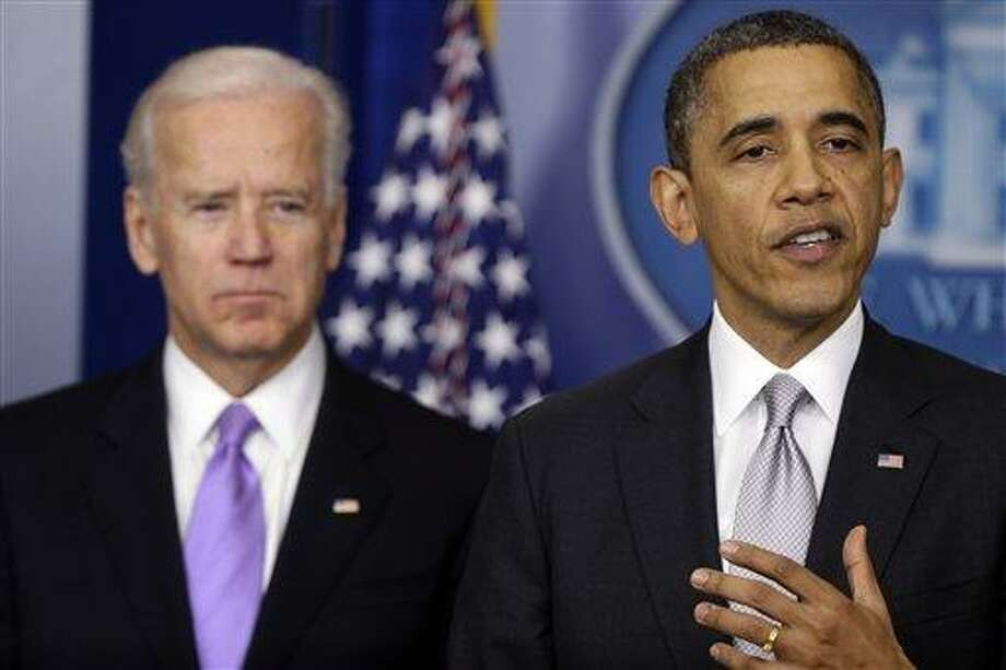 President Barack Obama stands with Vice President Joe Biden as he makes a statement Wednesdayin the Brady Press Briefing Room at the White House in Washington, about policies he will pursue following the massacre at Sandy Hook Elementary School in Newtown, Ct. Obama is tasking Vice President Joe Biden, a longtime gun control advocate, with spearheading the effort. AP Photo/Charles Dharapak Photo: AP / AP