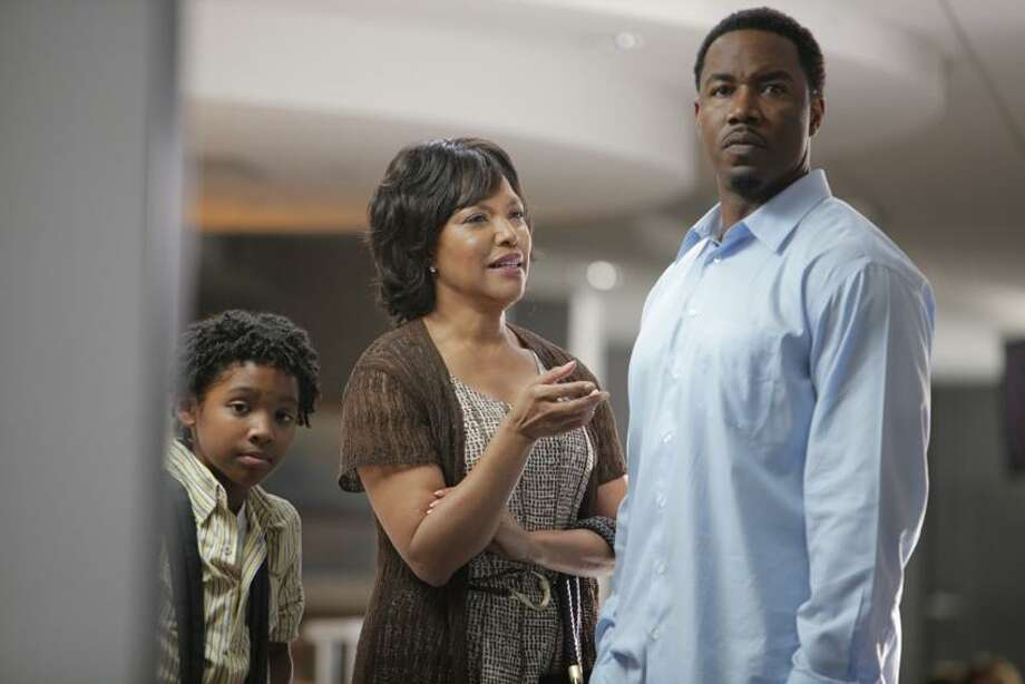 """GMC photo: Michael Jai White, who ran a martial arts studio in New Haven years ago, with Lynn Whitfield and a child actor in """"Somebody's Child,"""" Saturday night on GMC. / Copyright: 2011 Chris Davis"""