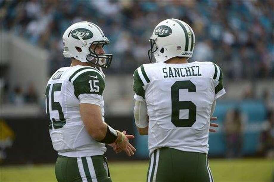 New York Jets quarterbacks Tim Tebow (15) and Mark Sanchez. (AP Photo/Phelan M. Ebenhack) Photo: AP / FR121174 AP