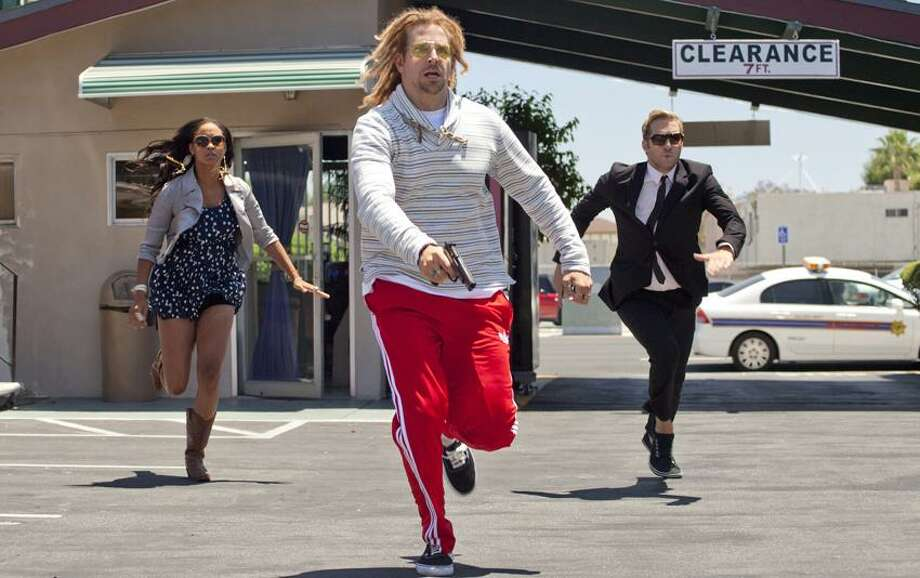 """Open Road Films photo: Yes, that's Bradley Cooper, center, in dreadlocks leading the charge, along with Joy Bryant and Ryan Hansen in a scene from """"Hit and Run."""" Photo: AP / AP2011"""