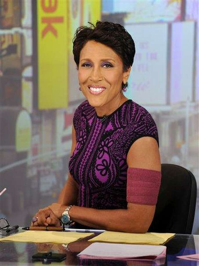 """This image released by ABC shows co-host Robin Roberts wearing an armband that covers her pic line chemotherapy treatment, on """"Good Morning America,"""" Tuesday, June 26, 2012 in New York. A national bone marrow donation registry says the rate of new registrants has more than doubled since ABC News' Robin Roberts said that she'll need a transplant. The """"Good Morning America"""" anchor is being treated for MDS, a blood and bone marrow disease. She will require a transplant this fall.  (AP Photo/ABC, Ida Mae Astute) Photo: AP / ©2012 American Broadcasting Companies, Inc.  All rights reserved."""