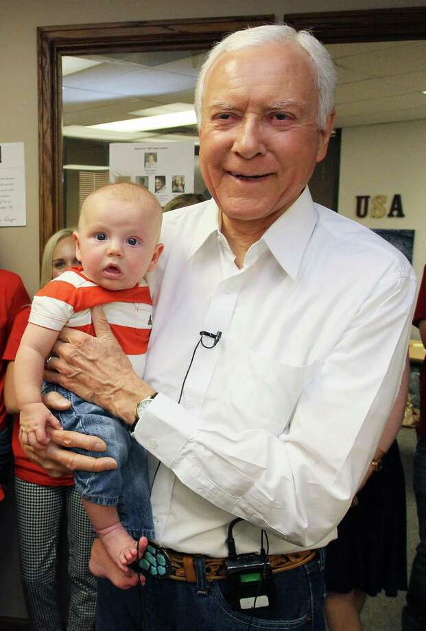 U.S. Senator Orrin Hatch, R-Utah, holds his 3-month-old great grandson, Beckham Wilson after arriving at his campaign headquarters to thank his staff and volunteers, Tuesday, June 26, 2012, in Salt Lake City. The 78-year-old, six term senator defeated challenger, Utah state Senator, Dan Liljenquist in a primary. (AP Photo/Colin E. Braley) Photo: ASSOCIATED PRESS / AP2012