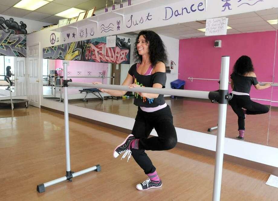 Mara Lavitt/New Haven Register photo: Robyn DiNatale of East Haven teaches Ballet Boot Camp in her dance studio, Attitude Dance & Fitness, 116 N. Main St. in Branford.