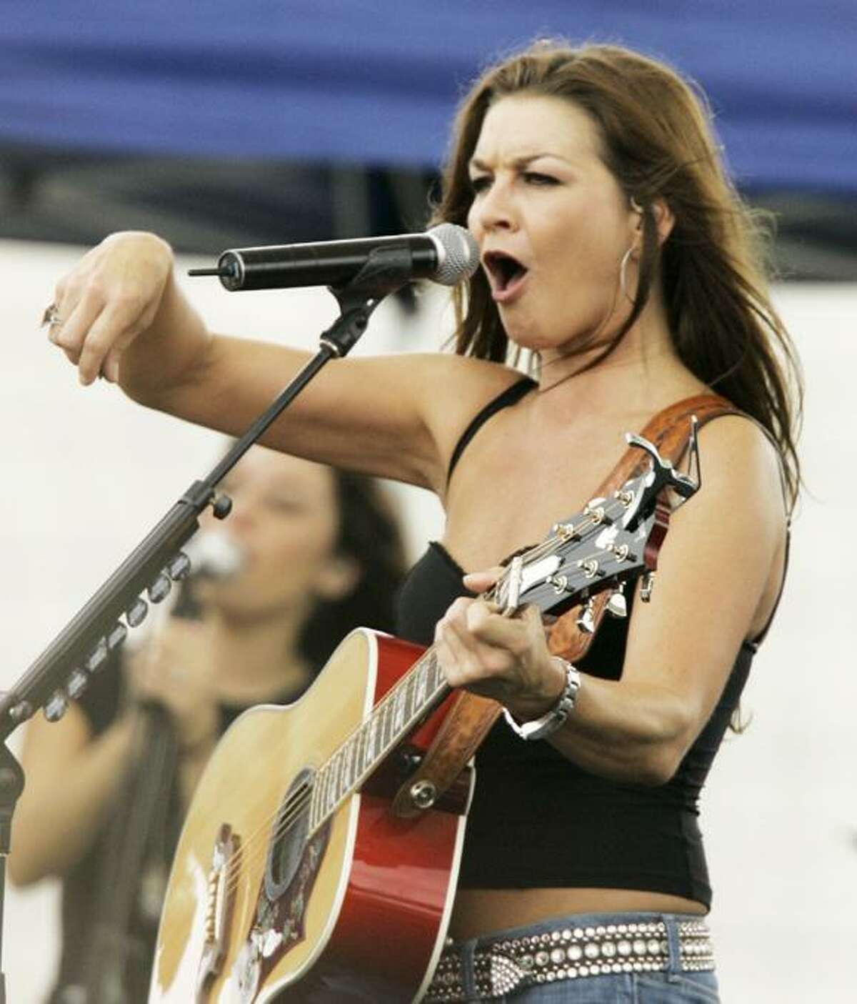 Country singer Gretchen Wilson performs for racing fans after practice for the Allstate 400 at the Brickyard auto race at the Indianapolis Motor Speedway in Indianapolis, Saturday, July 28, 2007. The 14th running of the race is Sunday. (AP Photo/Darron Cummings)