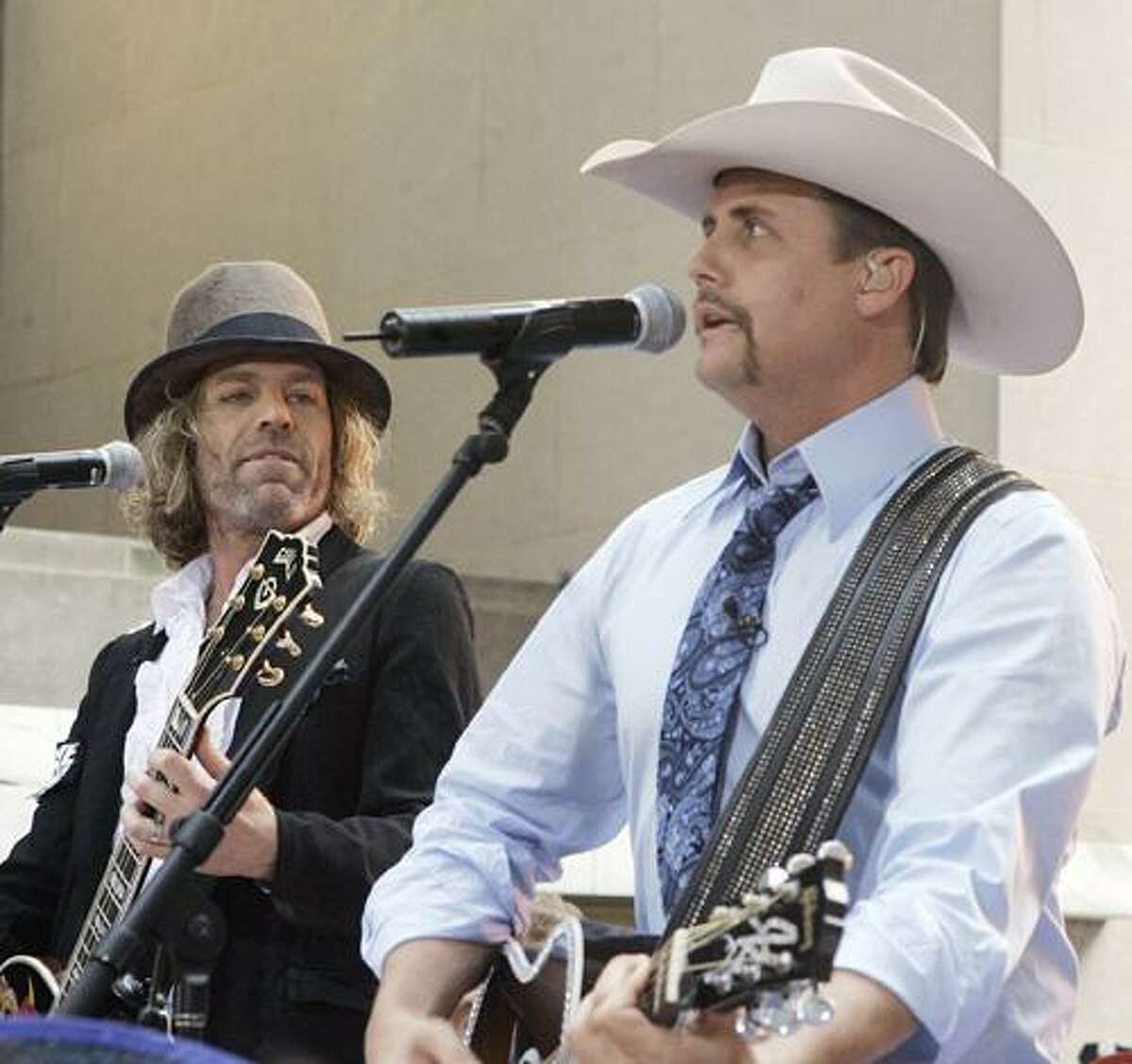 """Big Kenny, left, and John Rich, of the country music duo Big & Rich, perform on the NBC """"Today"""" television program in New York's Rockefeller Center, Friday June 1, 2007. (AP Photo/Richard Drew)"""
