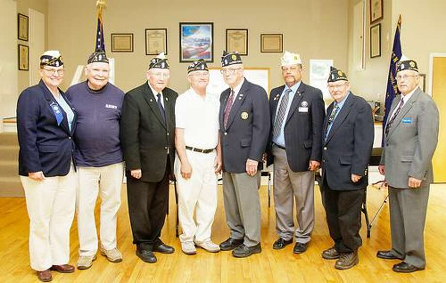 Photo Courtesy MADISON COUNTY AMERICAN LEGION Pictured from left, Sergeant of Arms Fran Holderman, historian Bradley Phillips, chaplain Robert Conway, 1st Vice Commander William Staley, 3rd Vice Commander L. James Button, 2nd Vice Commander Don Logan, Commander John Graham and Past Commander Joseph Barilla Sr.