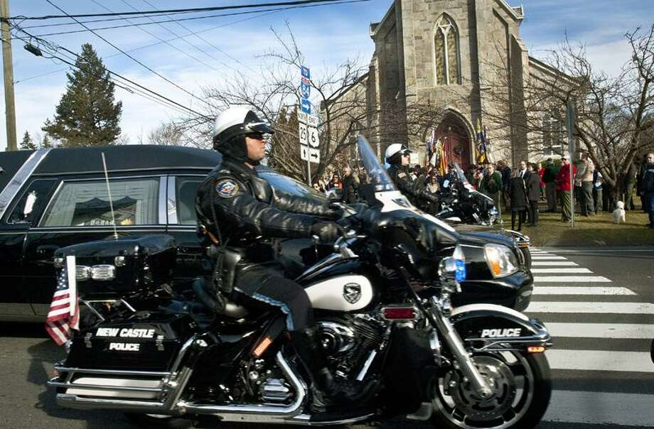 Sandy Hook-A hearse from another funeral passes the funerl of Ben Wheeler.  Melanie Stengel/Register