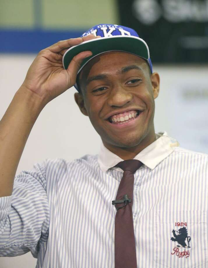 Simeon Career Academy's Jabari Parker smiles as he puts on a Duke University cap after announcing he will be attending Duke during a news conference at his high school on Thursday, Dec. 20, 2012, in Chicago. (AP Photo/Charles Rex Arbogast) Photo: AP / AP2012