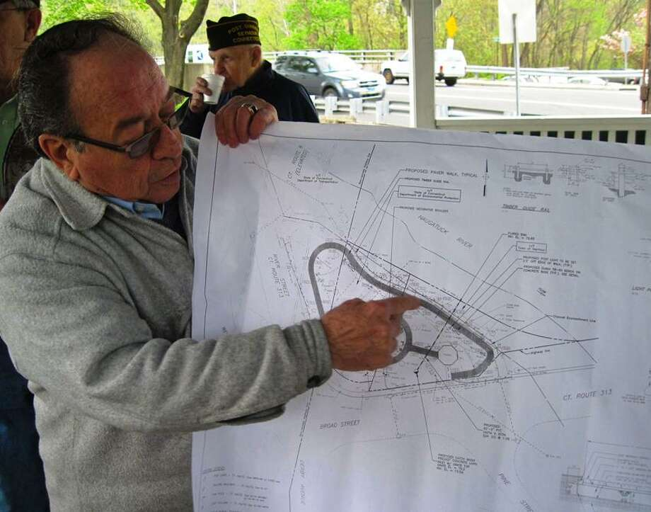 Veteran Al Yagovane points out plans for the park.  Patricia Villers/Register