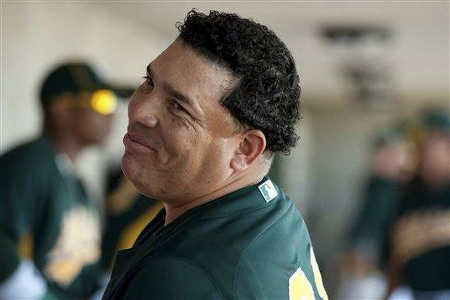 In this March 10, 2012, photo, Oakland Athletics starting pitcher Bartolo Colon smiles in the dugout before his start in a spring training baseball game against the Cincinnati Reds in Phoenix. Colon, a former Cy Young Award winner, was suspended for 50 games on Wednesday, Aug. 22, after testing positive for testosterone, joining San Francisco Giants outfielder Melky Cabrera on the suspended list for the rest of the regular season. (AP Photo/The Sacramento Bee, Jose Luis Villegas)  MAGS OUT; TV OUT (KCRA3, KXTV10, KOVR13, KUVS19, KMAZ31, KTXL40) ; LOCAL PRINT OUT (AUBURN JOURNAL, DAVIS ENTERPRISE, EL DORADO HILL TELEGRAPH; GRASS VALLEY UNION, LINCOLN NEWS MESSENGER, APPEAL DEMOCRAT MARYSVILLE, ROCKLIN PLACER HERALD, ROSEVILLE PRESS TRIBUNE, THE STOCKTON RECORD) MANDATORY CREDIT Photo: AP / The Sacramento Bee