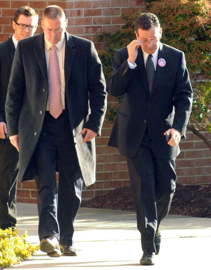 Gov. Dannel Malloy right leaves Charlotte Bacon's funeral at Christ the King Lutheran Church, Newtown. Mara Lavitt/New Haven Register12/19/12
