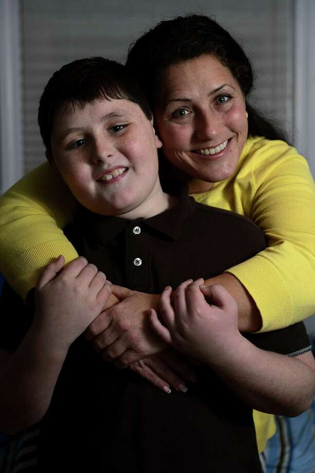 Julie Shafer and her son Caleb Shafer Courder, 10, they talk about Caleb's Asperger's diagnosis at their home in Quaker Hill, Connecticut on Wednesday, December 19, 2012. AAron Ontiveroz, The Denver Post Photo: DP / (C) 2012 The Denver Post, MediaNews Group