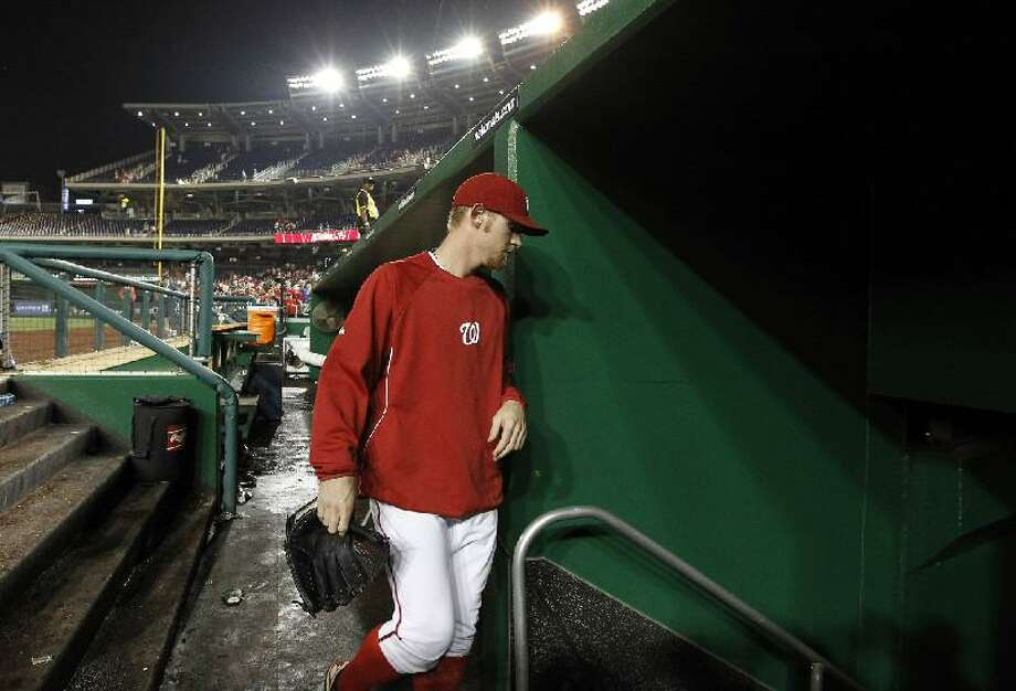 ASSOCIATED PRESS Washington Nationals starting pitcher Stephen Strasburg heads into the clubhouse after getting a 4-1 win Tuesday against the Atlanta Braves at Nationals Parkin Washington. Nationals manager Davey Johnson said Wednesday that Strasburg could miss his final two to three starts.