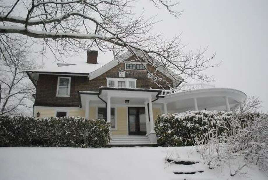 MIKE AGOGLIATI/Register Citizen This Victorian in Winchester is listed with Elyse Harney Real Estate. Its location on a hilltop, the sellers say, makes it a charming location for a new homeowner.