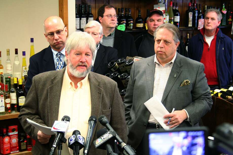 "Photo courtesy of Brian Sundie State Rep. Craig Miner, R-Litchfield, speaks during a rally at Goshen Wine & Spirits on Saturday. He and other legislators and business owners gathered to speak their opposing views against a proposed bill that would allow liquor sales on Sundays, extended hours for bars, and other changes that bill supporters say will make Connecticut ""more competitive with its neighbors."" Gov. Dannel Malloy says the changes will also bring millions in much-needed revenue to the state."