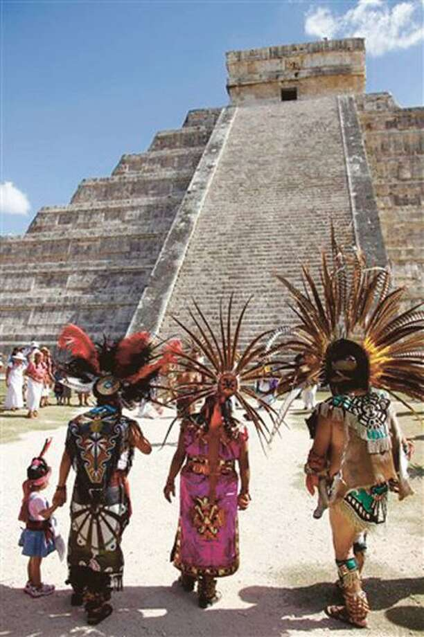 AP Photo by ISRAEL LEAL Mayan gather in front of the Kukulkan Pyramid in Chichen Itza, Mexico on Thursday. A Mexican Indian seer who calls himself Ac Tah said he holds high hopes for today. Photo: AP / AP