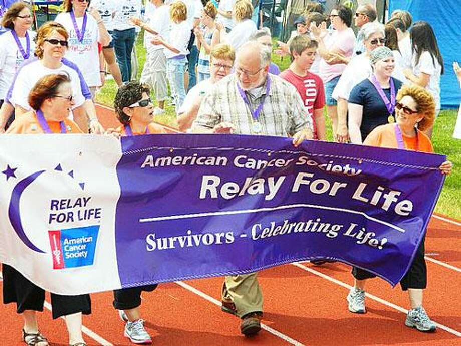 Photo Courtesy RELAY FOR LIFE CAMPAIGN Former Oneida Mayor Leo Matzke marches with other survivors at the Oneida Relay for Life.