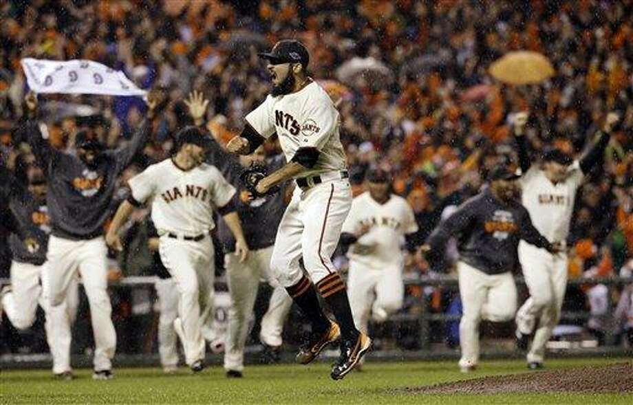 San Francisco Giants relief pitcher Sergio Romo reacts after the final out in Game 7 of baseball's National League championship series against the St. Louis Cardinals Monday in San Francisco. The Giants won 9-0 to win the series. Associated Press Photo: AP / AP