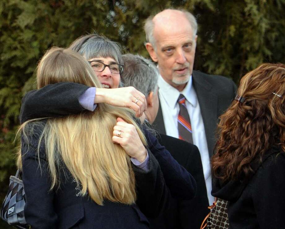 Bill Leukhardt, right,with mourners  after a memorial service for Lauren Rousseau, at the First Congregational Church in Danbury, Conn.  Thursday, December 20, 2012. Rousseau and her mother Teresa Rousseau lived with Leukhardt. Leukhardt  and Teresa Roussea are partners.  Lauren Rousseau was  a substitute teacher killed by a gunman that also claimed the lives of 5 other educators  and 20 children at the Sandy Hook Elementary School shooting Friday, December 15, 2012.  Leukhardt Photo by Peter Hvizdak / New Haven Register Photo: New Haven Register / ©Peter Hvizdak /  New Haven Register