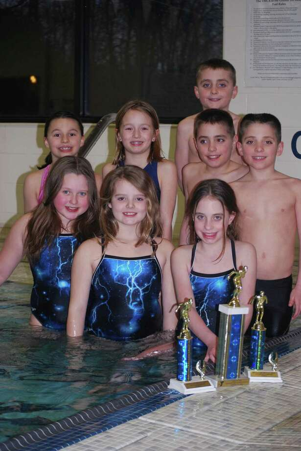 Submitted Photo The Oneida YMCA Dolphins swim team pose with Class E trophies from a recent meet. The team is, from left, (front) Hannah Dougall, Darien Tompkins, Mattie Hicks; (middle) Ryleigh Bickom, Porter Russ, Aidan Hicks, Ajay Hicks and (back) Drew Hicks. Other Class E swimmers not pictured are Lucas Tracy, Claire Breckenridge, Molly Forbes, Alex Mecca, Siena Burger, Hannah Kellogg.