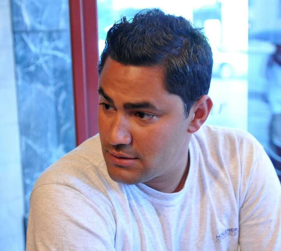 Brian Morales of New Haven talks about the Supreme Court ruling on the Arizona immigration law.  Peter Casolino/New Haven Register