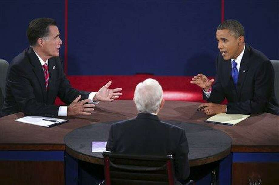 Republican presidential nominee Mitt Romney and President Barack Obama answer a question during the third presidential debate at Lynn University, Monday. AP Photo/Pool-Win McNamee Photo: AP / Getty Pool
