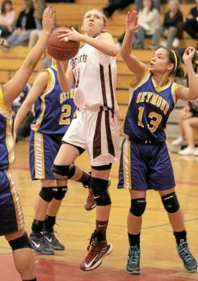 Nicole Kozlak of the Lady Raiders goes to the hoop as Seymour's Aleesha Johnson (13) tries to block. Photo by Marianne Killakey/Special to Register Citizen / 2012