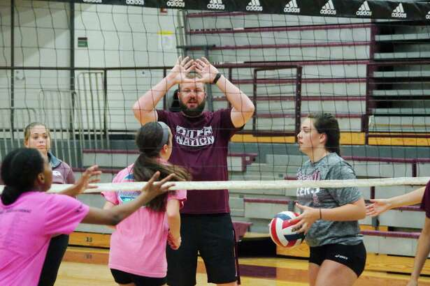Pearland volleyball coach Christian Dunn demonstrates hitting technique during Pearland summer volleyball camp Tuesday, Jul. 25.