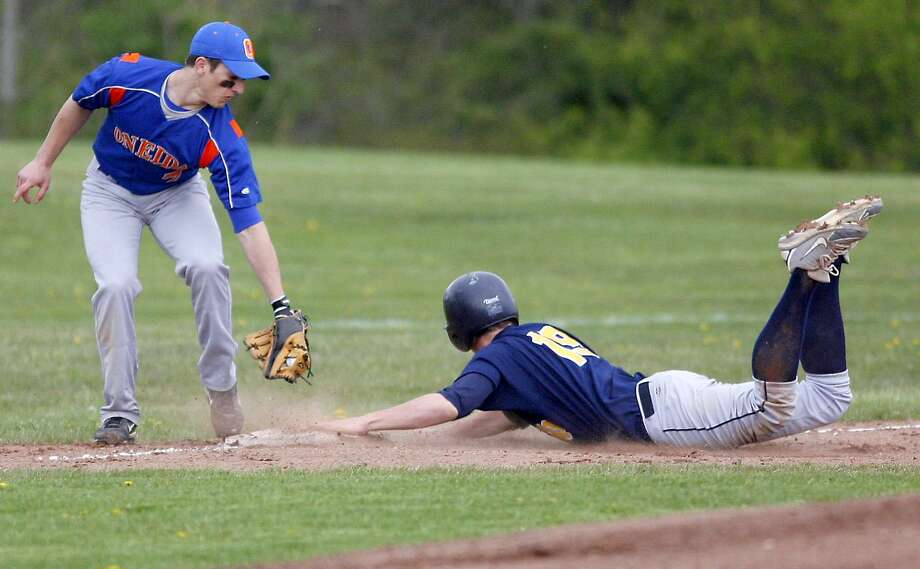 """Dispatch Staff Photo by JOHN HAEGER <a href=""""http://twitter.com/oneidaphoto"""">twitter.com/oneidaphoto</a> UND Zane Smith (19) slides into third ahead of the tag of Oneida Jordan Koons (7) for the extra base in the top of the first inning of play in Oneida on Thursday, April 26, 2012."""