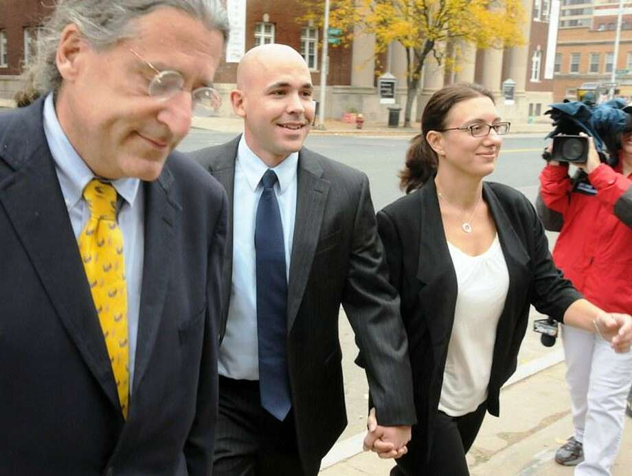 East Haven Police Officer Jason Zullo center with attorney Norman Pattis left and an unidentified woman right walks to Federal Courthouse in Hartford. Zullo was changing his not-guilty plea in the East Haven police profiling case. Mara Lavitt/New Haven Register 10/23/12