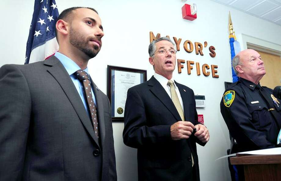 East Haven Mayor Joseph Maturo, Jr., (center) flanked by Town Attorney Joseph Zullo (left) and East Haven Police Chief Brett Larrabee (right) speaks to the press about a settlement agreement with the Department of Justice at East Haven Town Hall on 10/23/2012.Photo by Arnold Gold/New Haven Register   AG0468B